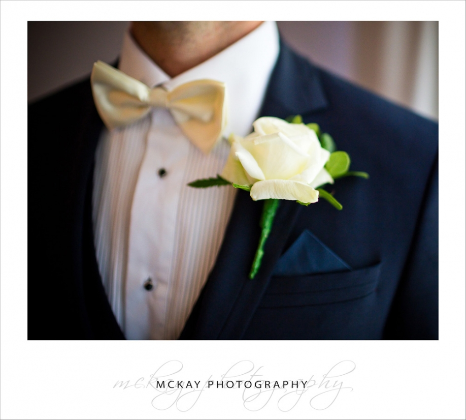 close up groom details bow tie