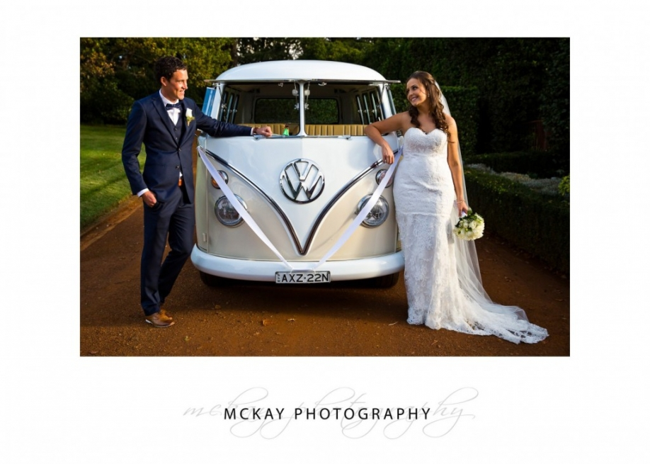 Bride and groom and combi wedding car