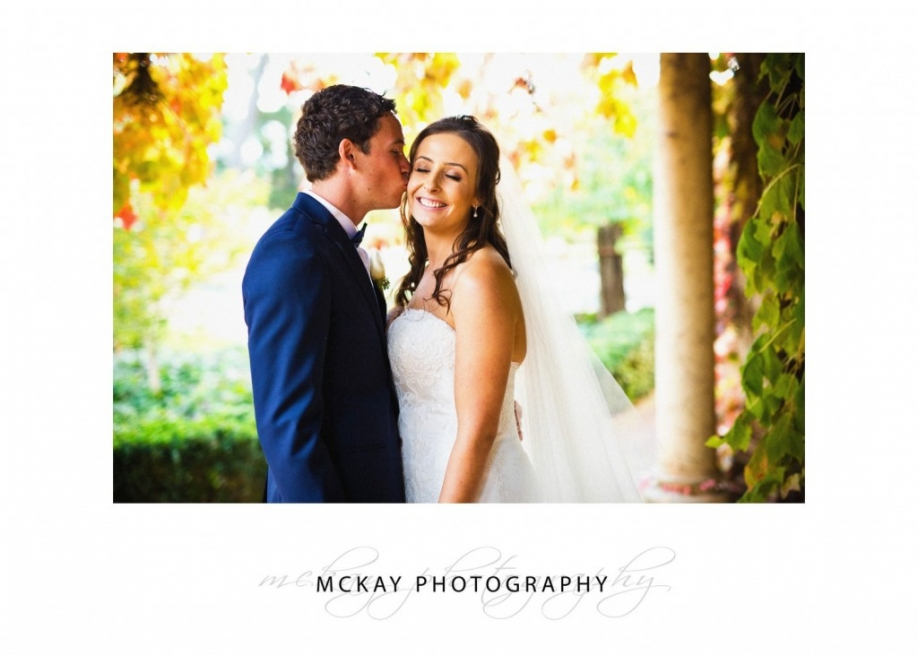 Bride and groom autumn leaves Bowral