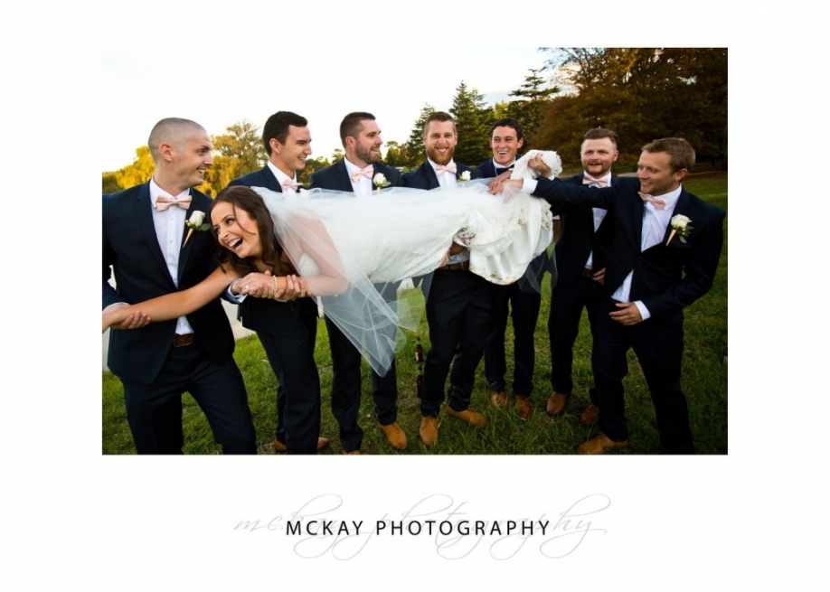 Boys carrying bride
