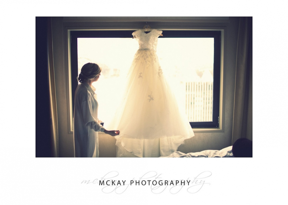Bride and dress hanging up