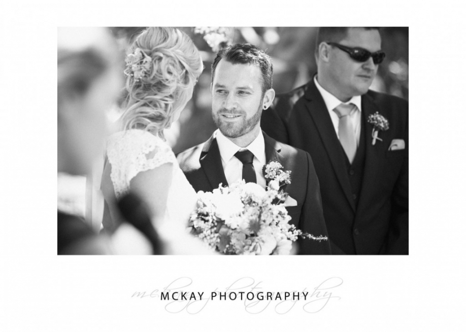Groom looking at bride - black and white photo