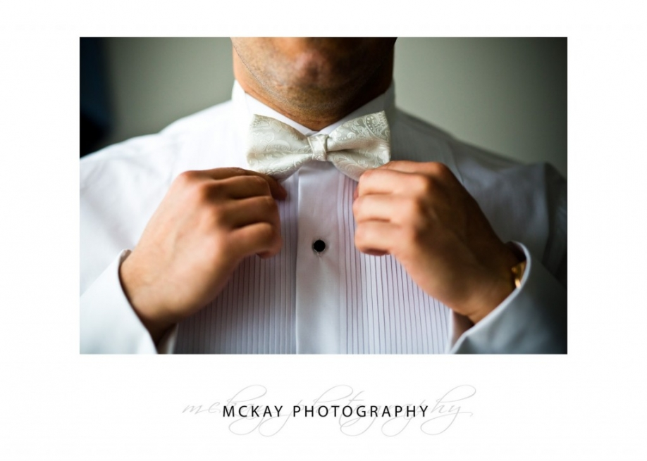 Close up of grooms bow tie