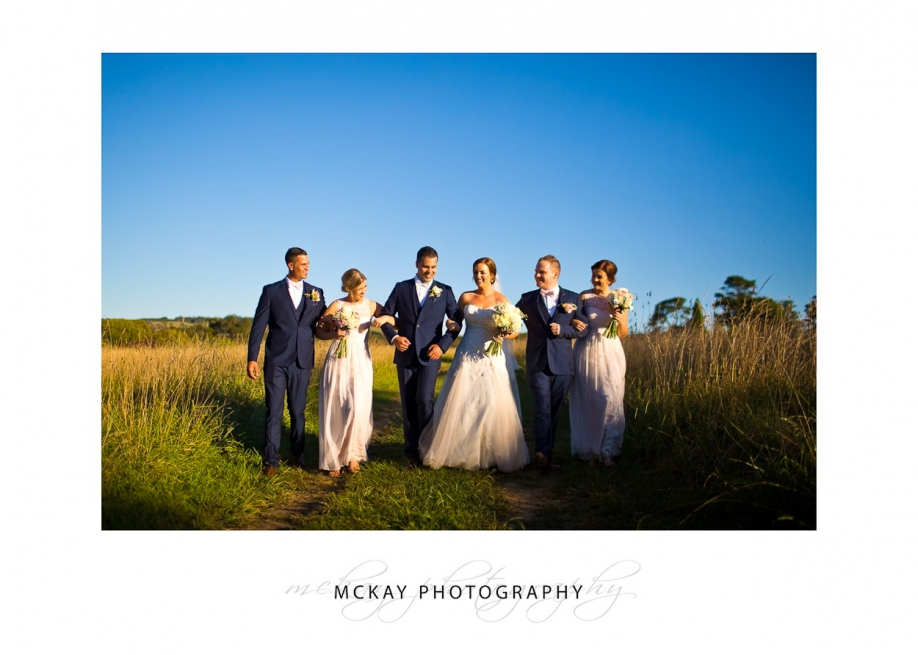 Bridal party in the field at Night shot at Bendooley Estate