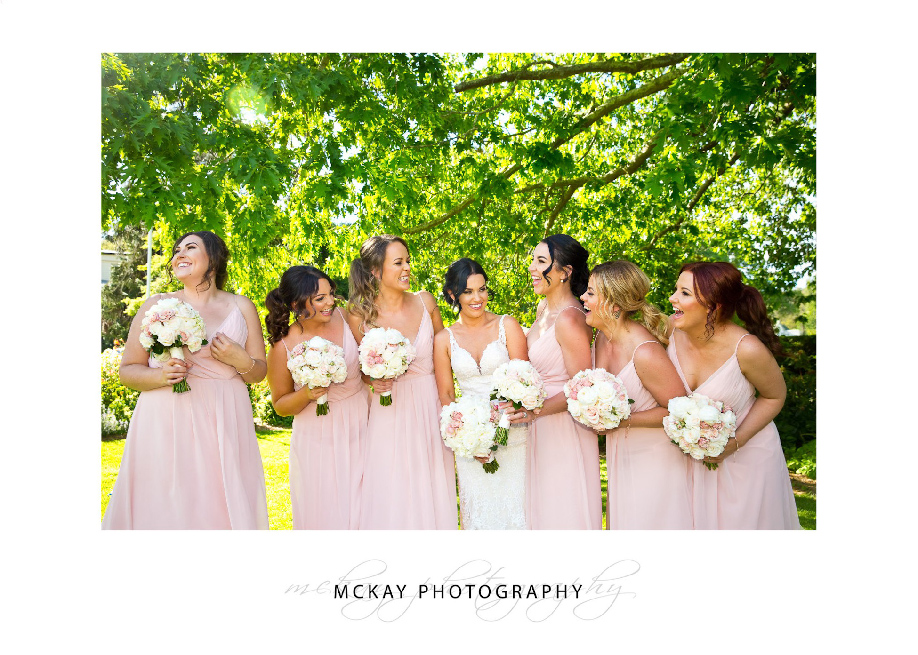 All the girls laughing under tree leaves Bowral wedding