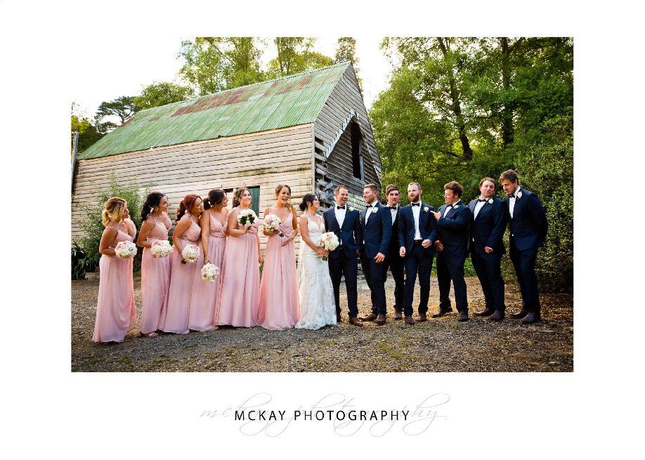 Bridal party photo at old barn