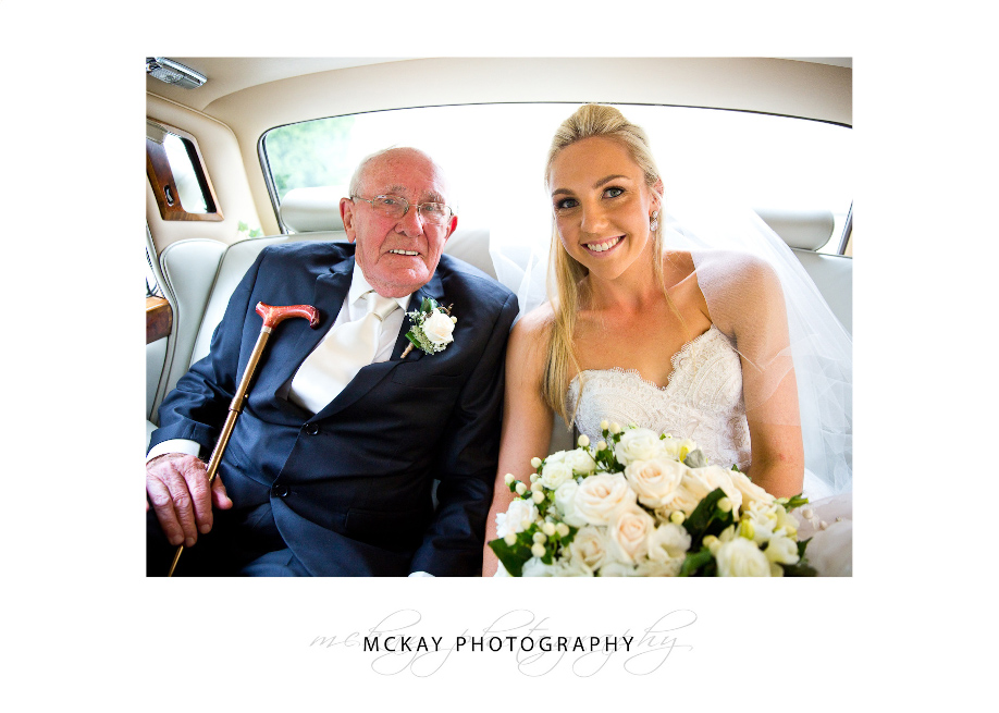 Bride and grandfather in wedding car