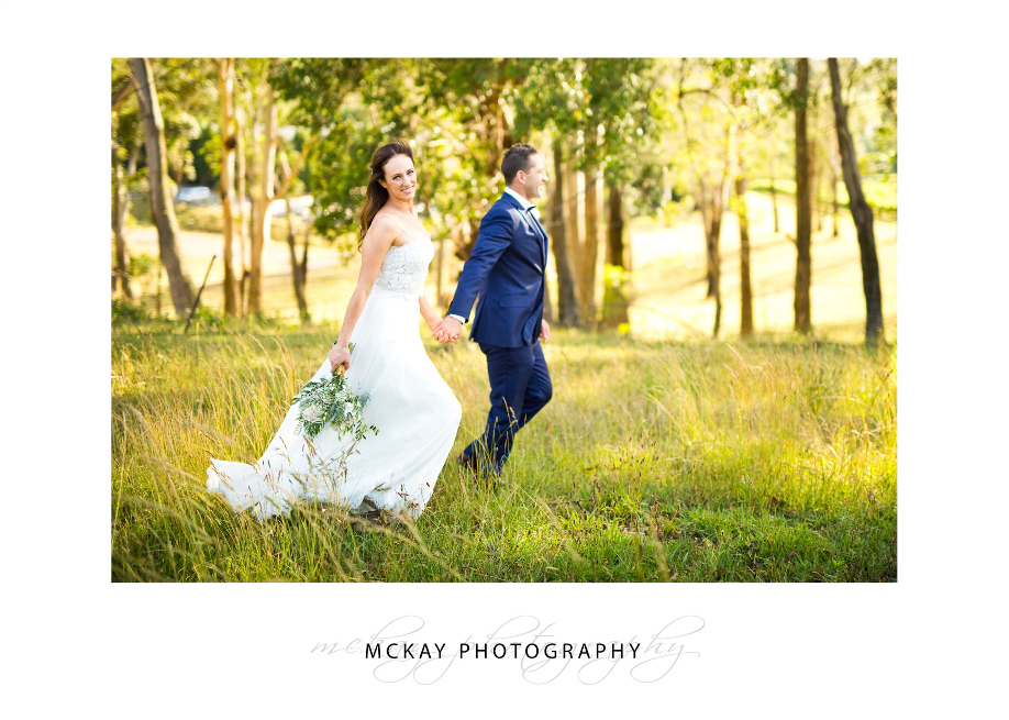 Long grass wedding photo at Centennial Vineyards Bowral