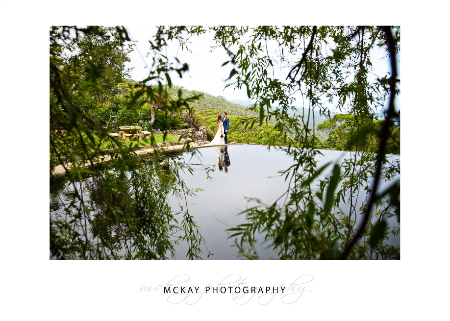Wedding at Tumbling Waters Retreat photo pool reflection through willows