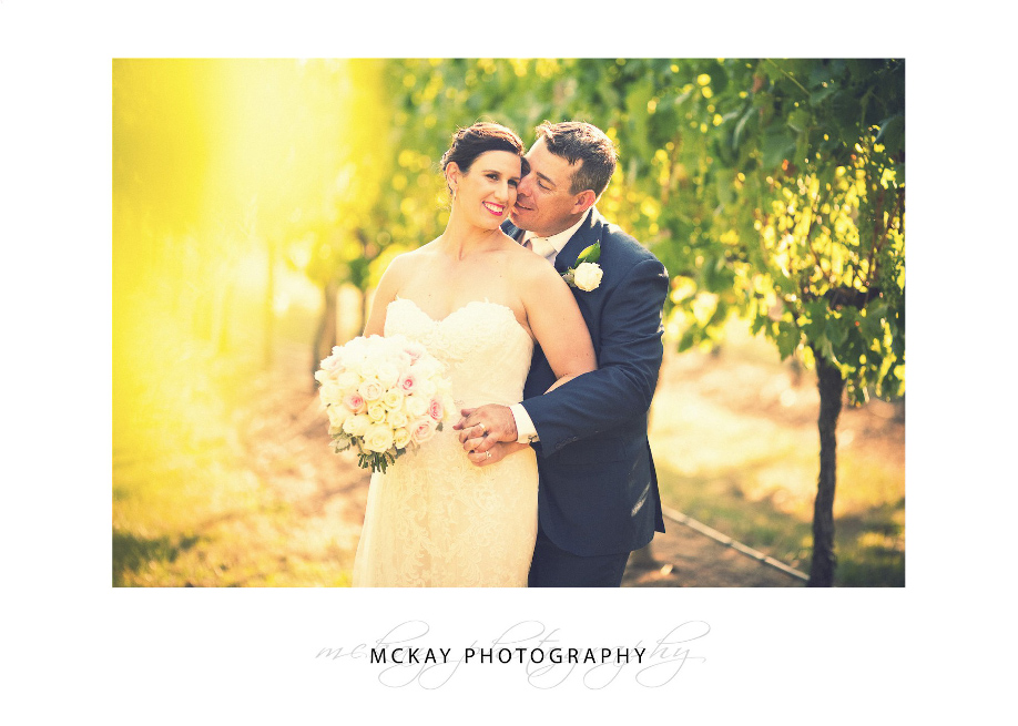 Romantic photo in the vine rows wedding Bowral