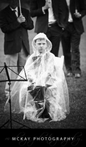 Boy sitting in rain unhappy weather rain