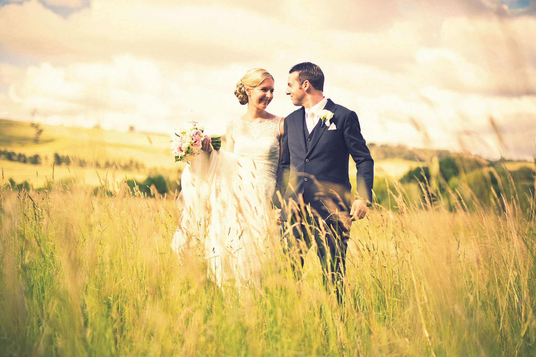 Lauren Rob grass field Bowral wedding photographer