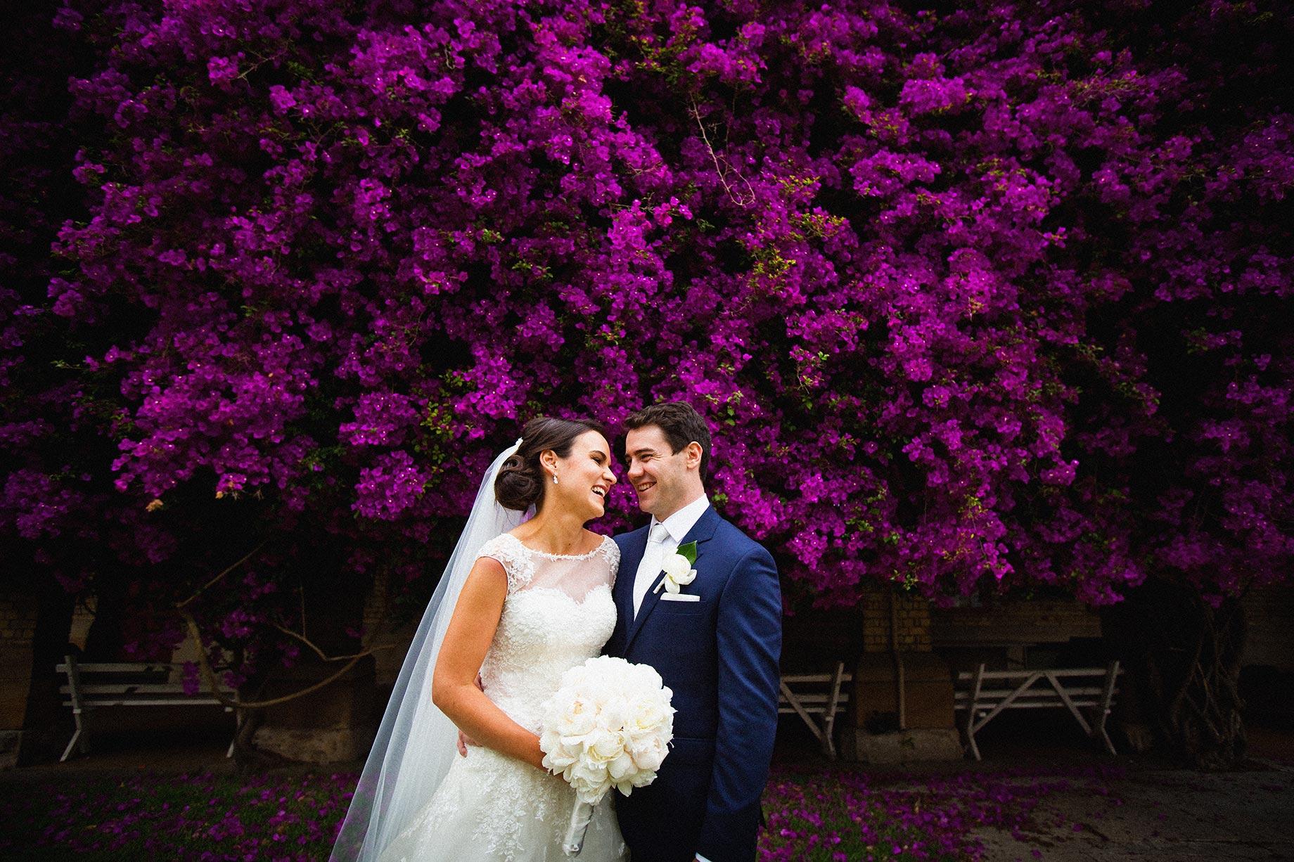 bride groom laughing purple flowers Riverview wedding