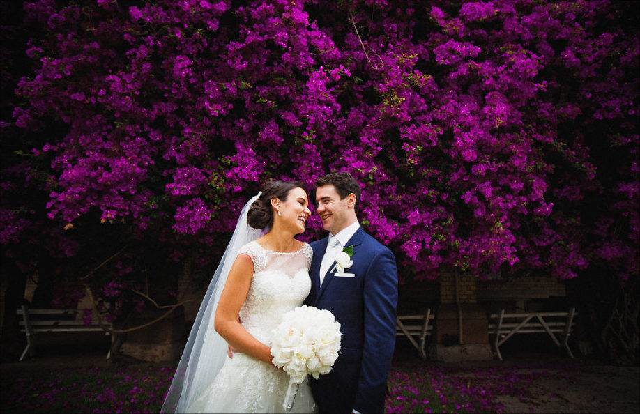 bride groom laughing purple flowers Riverview wedding