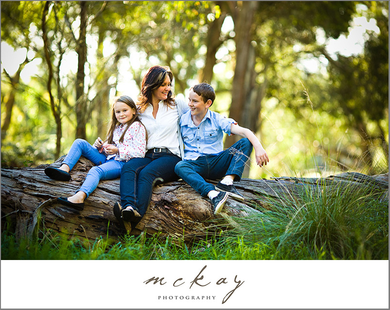 bowral family photo on a fallen gum tree