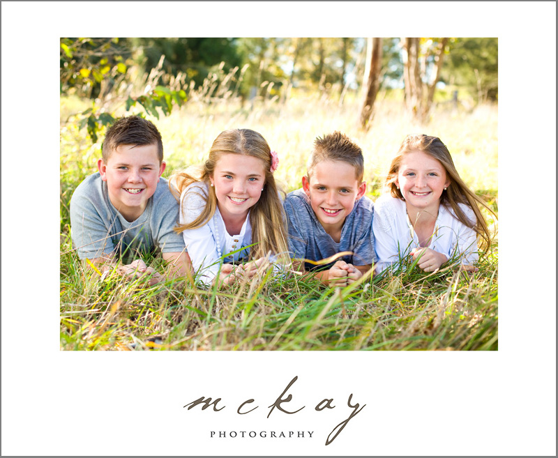 kids family photo in long grass