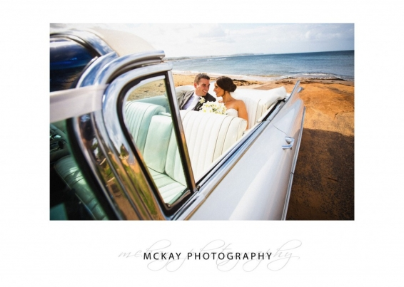 Wedding photo in a very cool Cadillac
