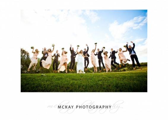 Bridal party jump photo