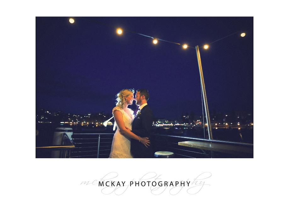 Krystle & Adam under lights at Manly Skiff Club wedding