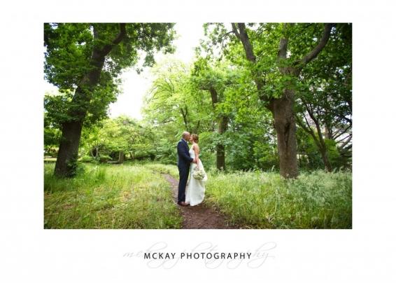Bride groom in grass field
