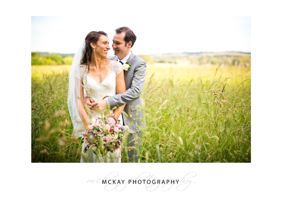Bride groom grass field Bowral wedding