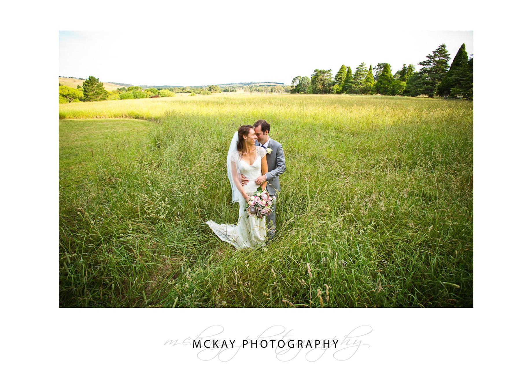 Grass field wide shot wedding photo