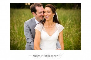 Laughing in grass field wedding Bowral
