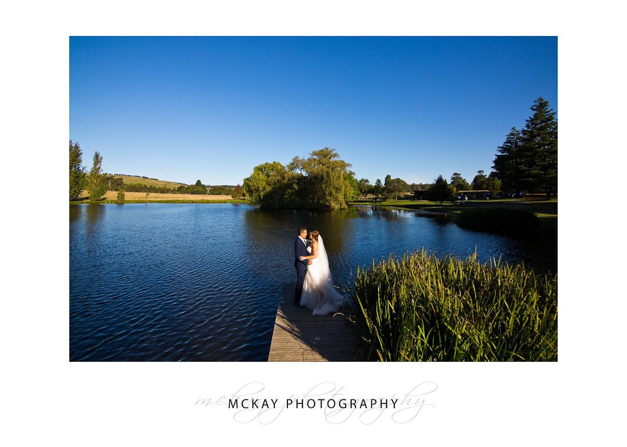 Bride and groom lakeside at Night shot at Bendooley Estate