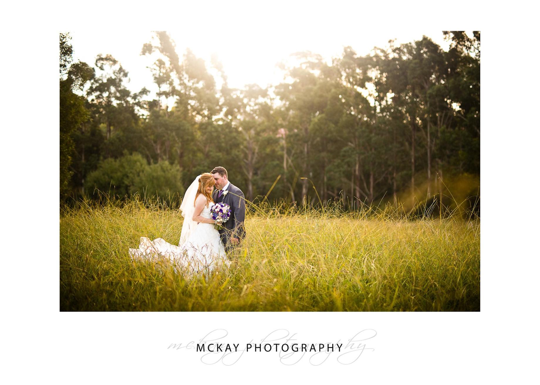 Bride & groom grass field wedding photo Bowral