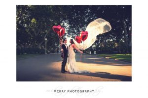 Nicole Luis wedding photo Hyde Park red love balloons