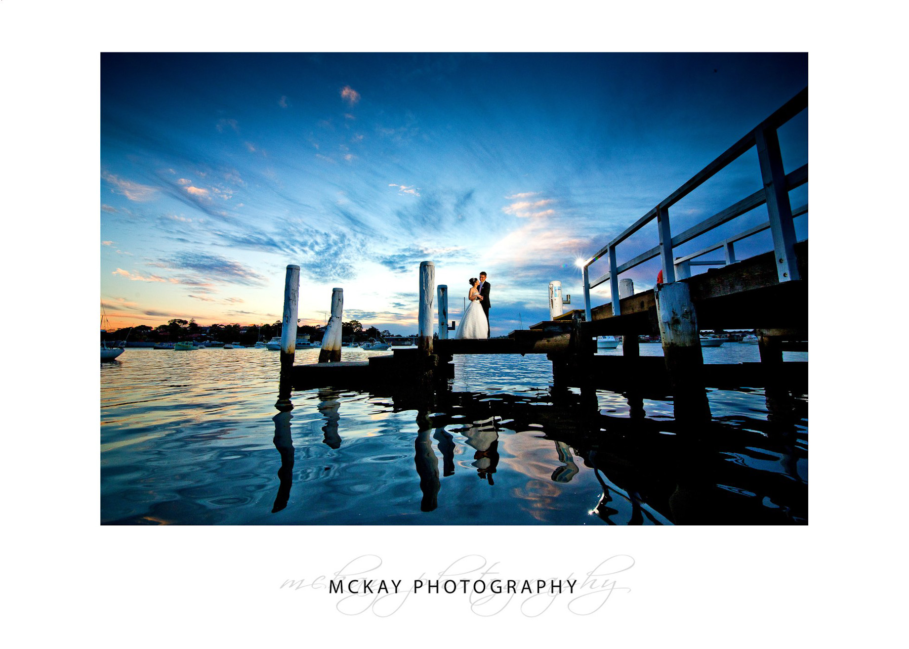 Wedding sunset photo old dock at Le Montage