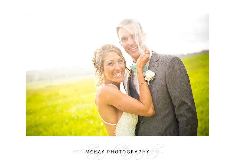 Veil and sun shower wedding photo at Briars Bowral