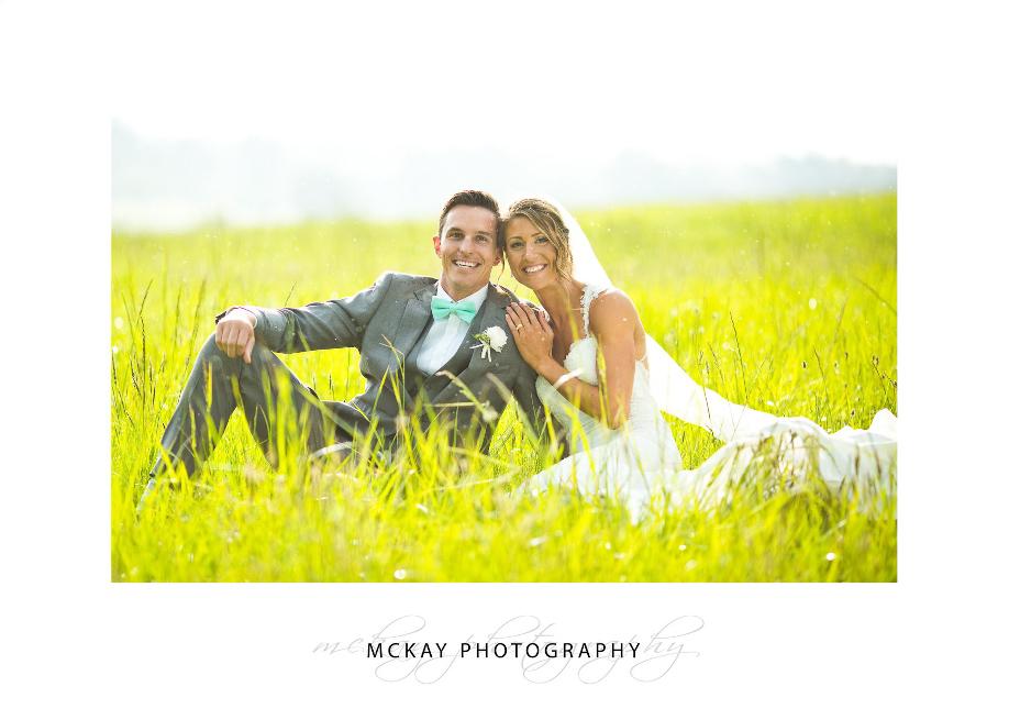 Celia & Michael in grass field near Briars Southern Highlands wedding