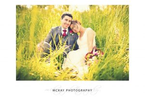 Louisa Andrew wedding at Briars photos in grass field