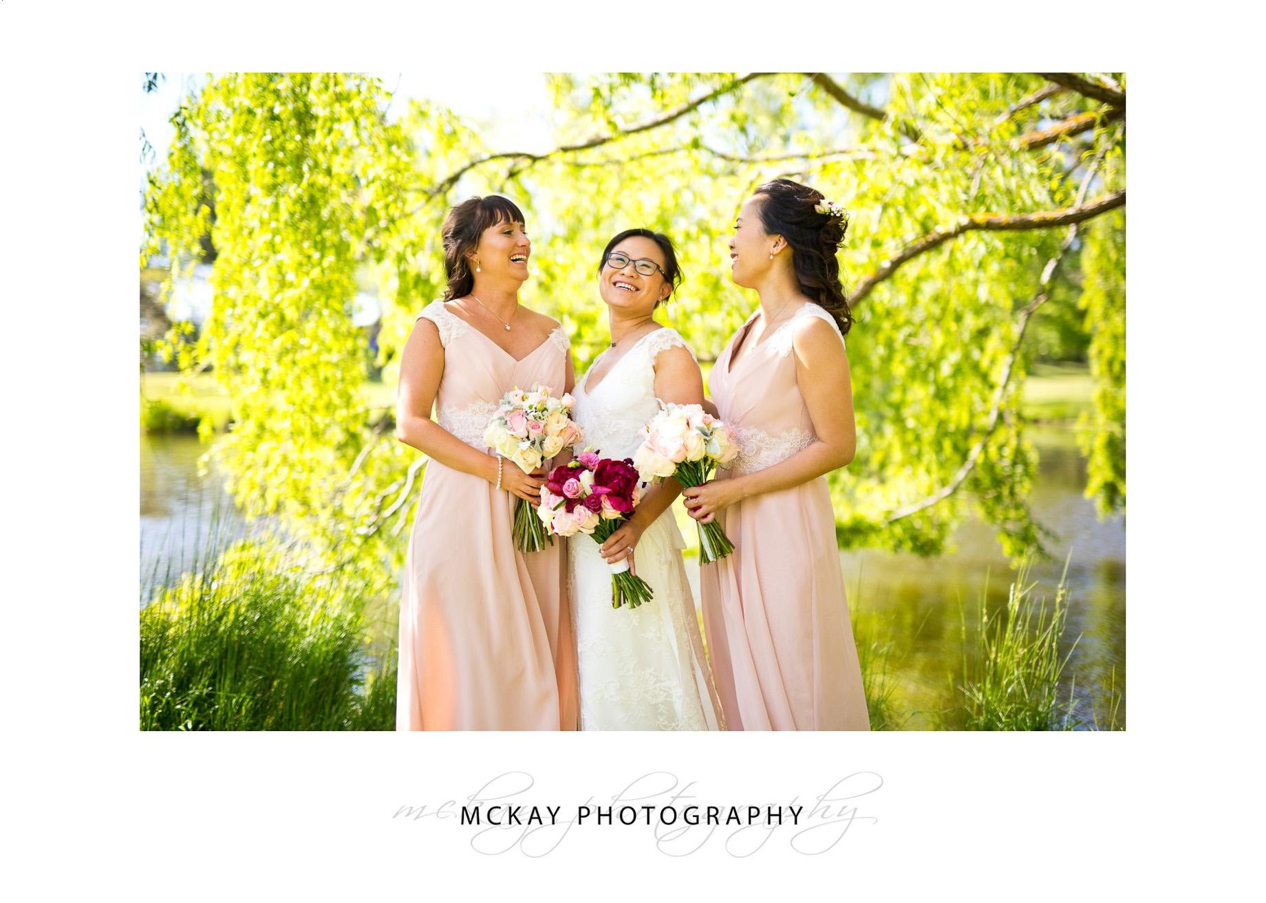 Louisa & bridemaids near willow tree and lake at Briars