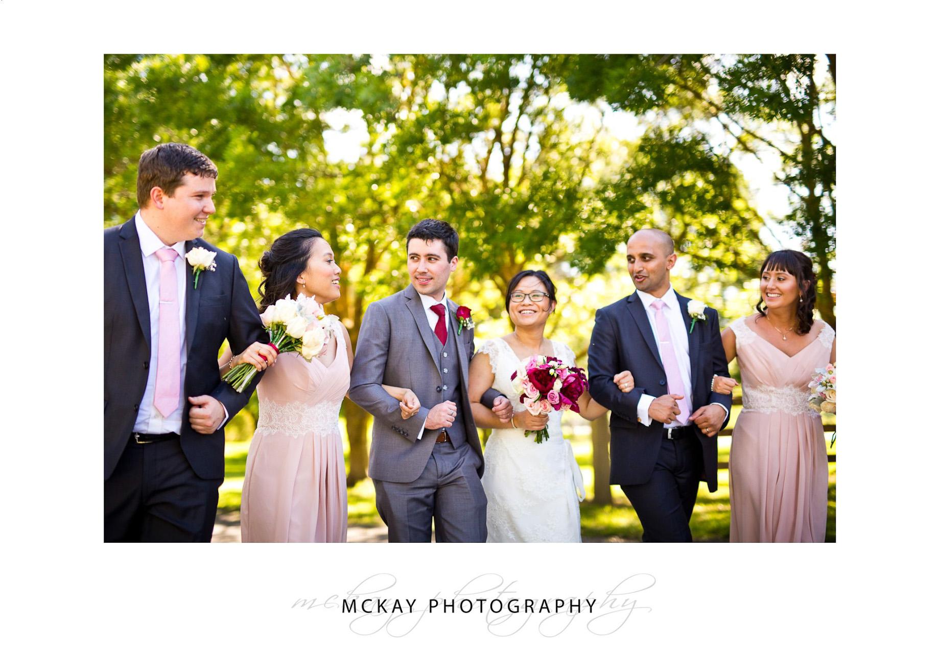 Bridal party walking at Briars