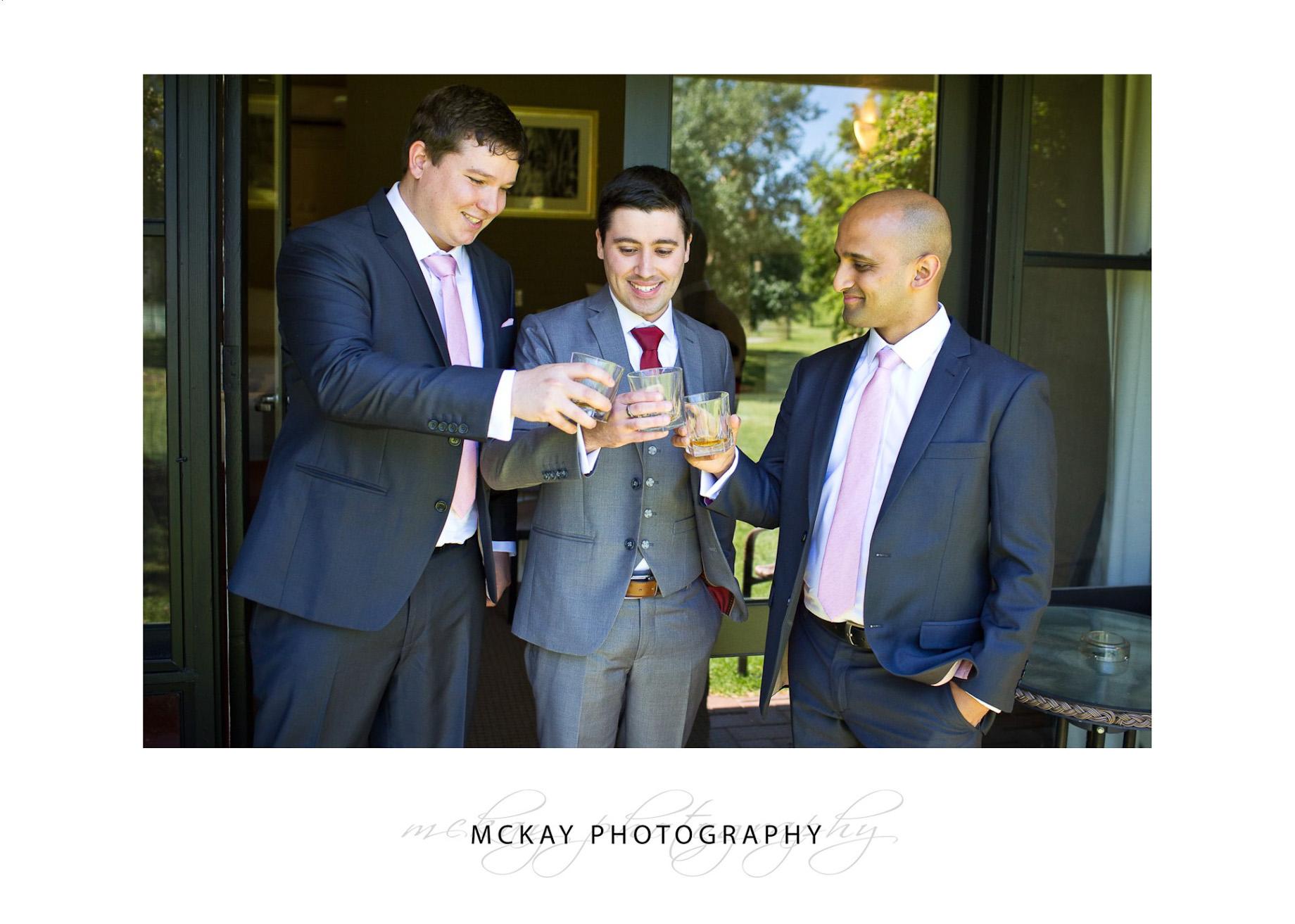 Boys drinking scotch wedding drinks