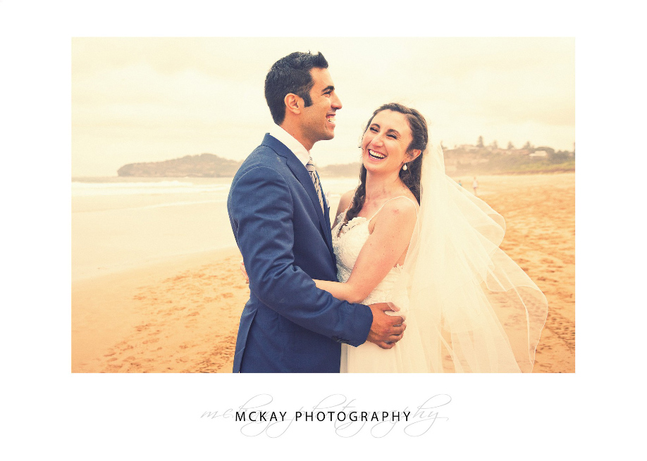 Photo on the beach laughing bride groom