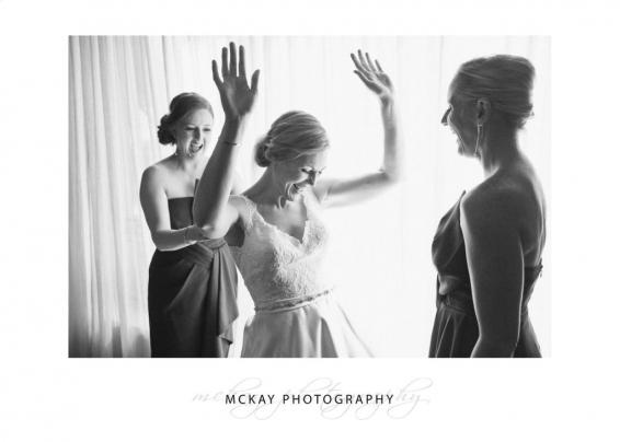 Bride preparations black white photo