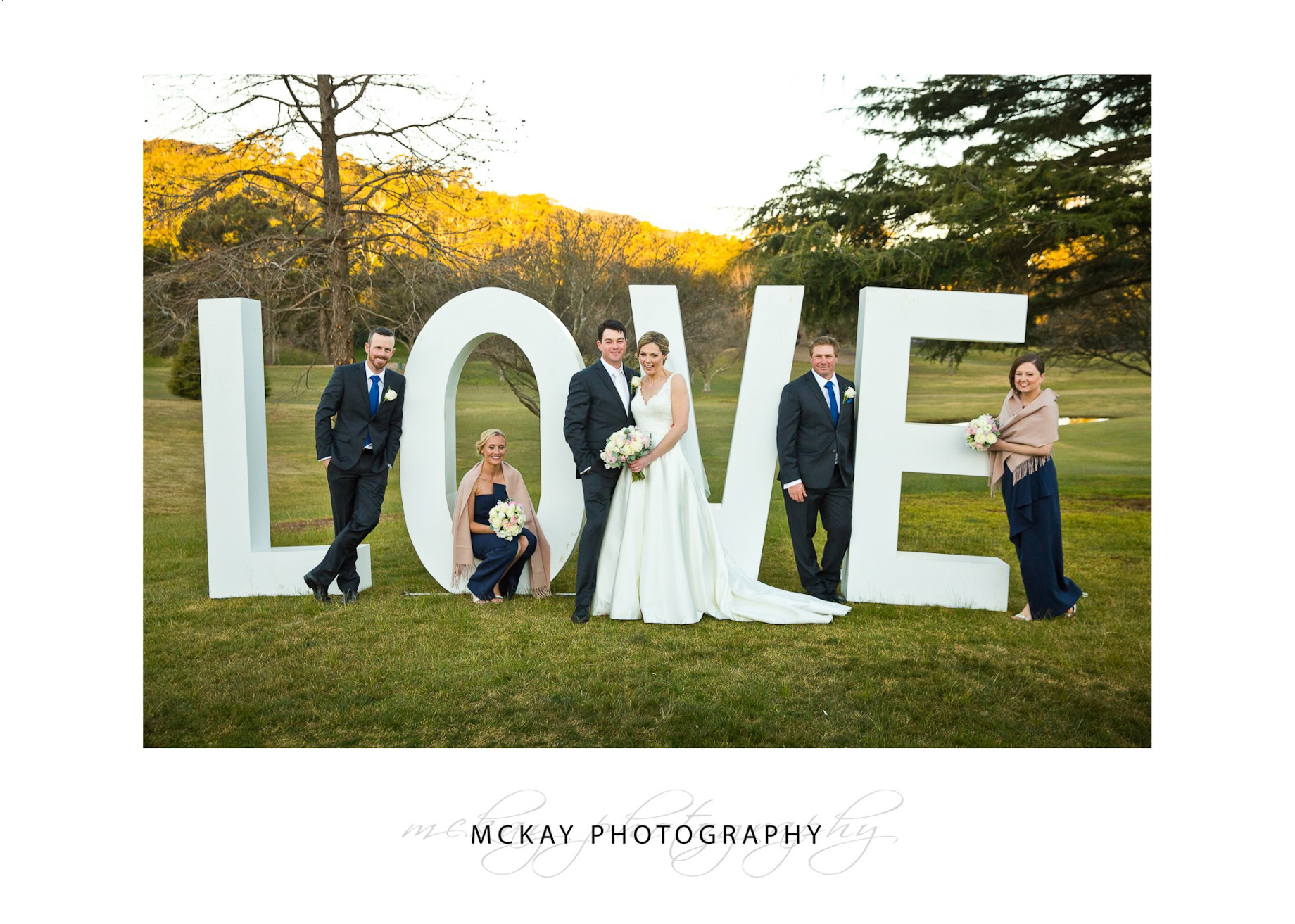 Bridal party and LOVE sign letters