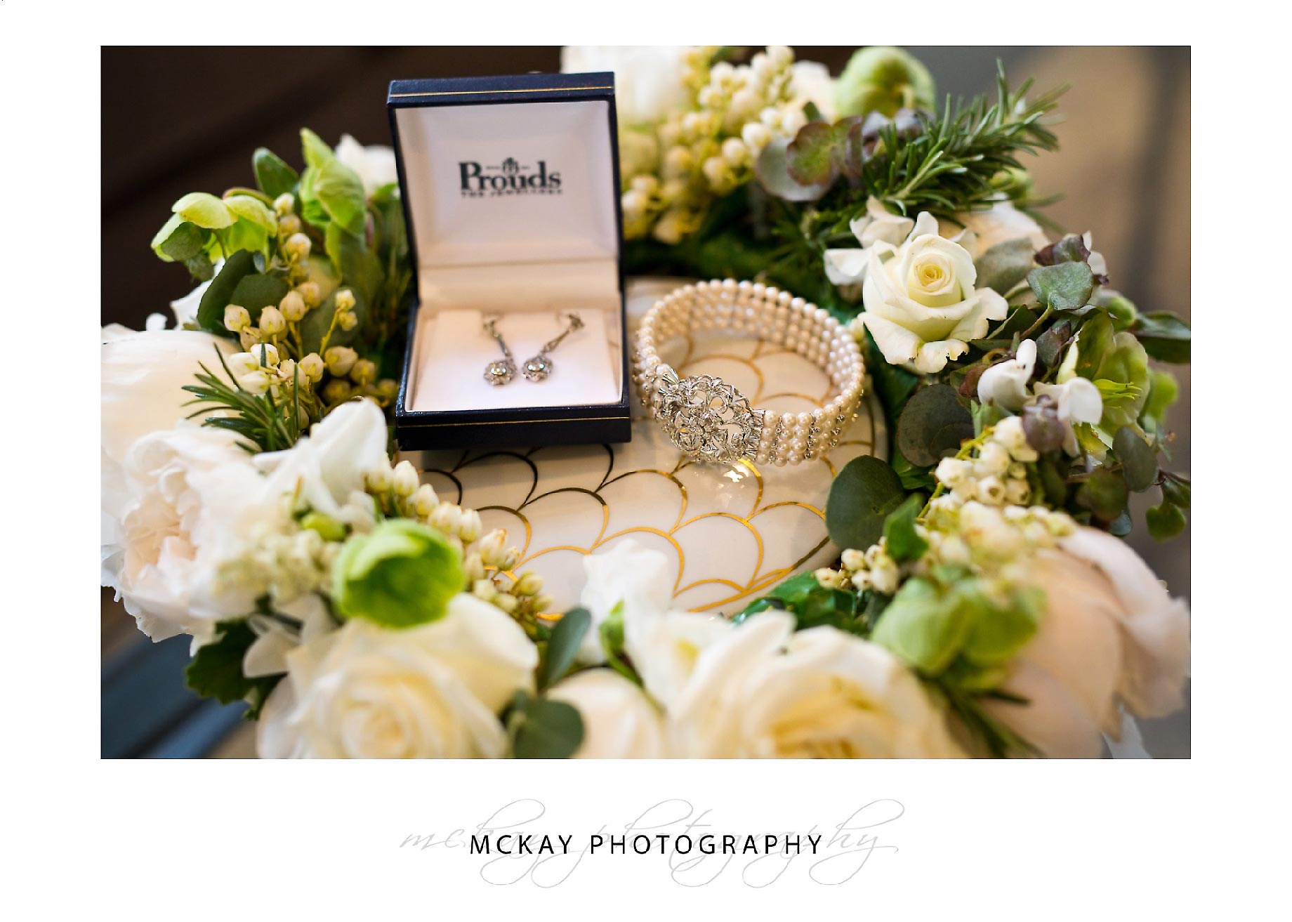 Bride flower and jewellery detail photo