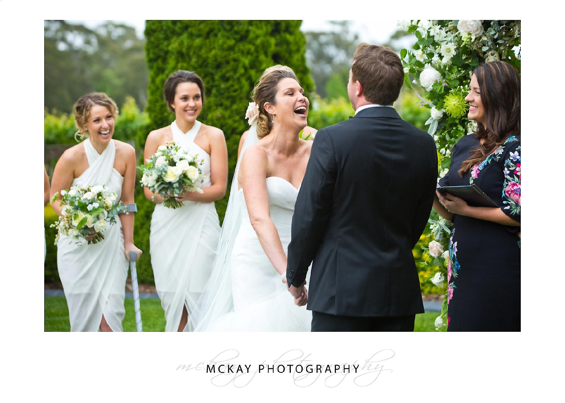 Bride laugh during wedding ceremony candid