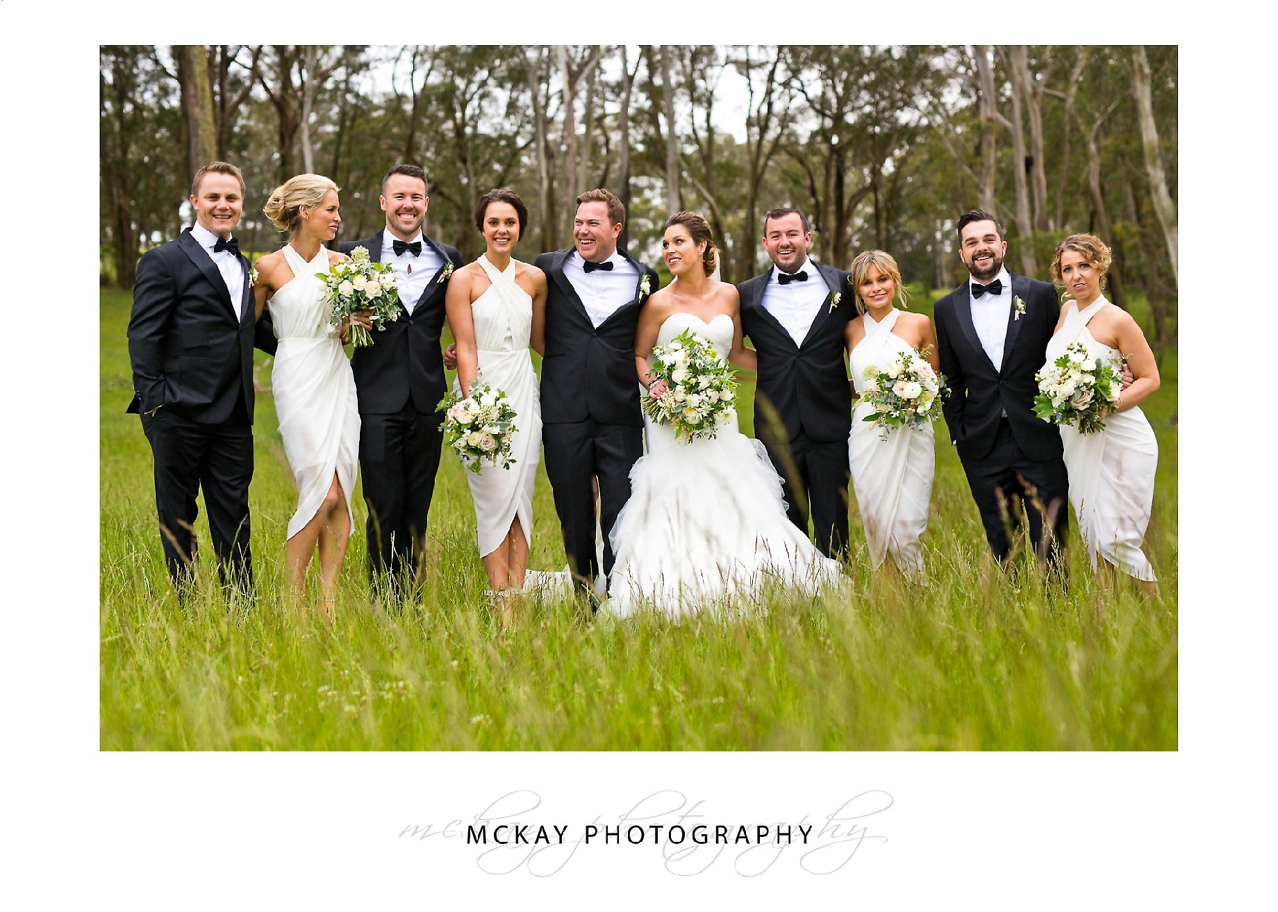 Bridal party in long grass photo Bowral