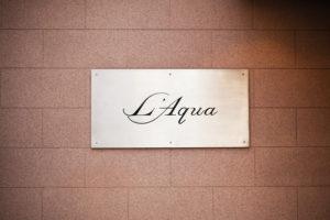 L'Aqua sign logo