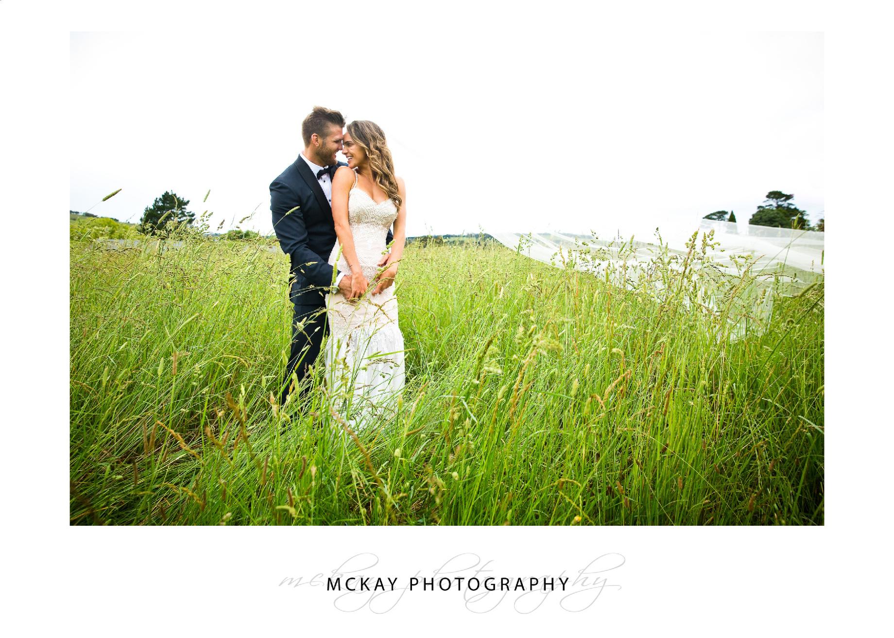 bride groom grass field photo
